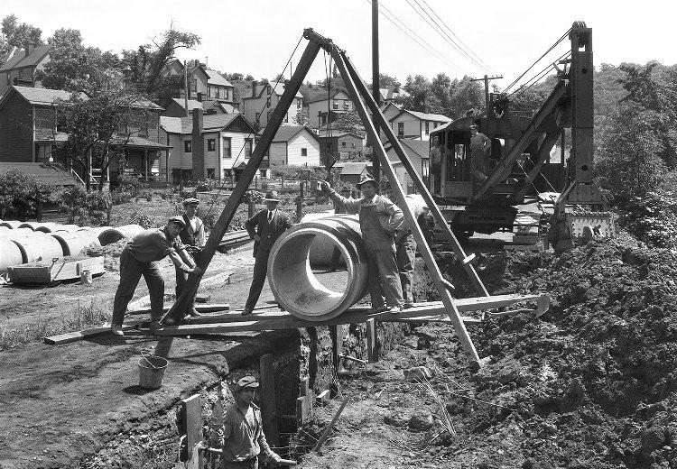Historic photo from 1926 of crews installing a sewer main