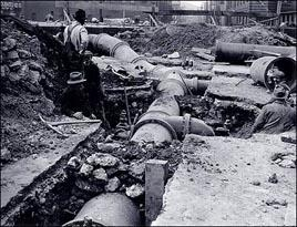 Old pipe construction in street, Pittsburgh.