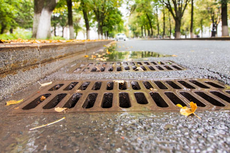 Image of a catch basin or storm drain on a city street