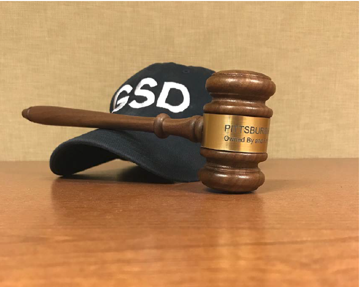 A Get Stuff Done hat along with a PWSA Board of Directors gavel
