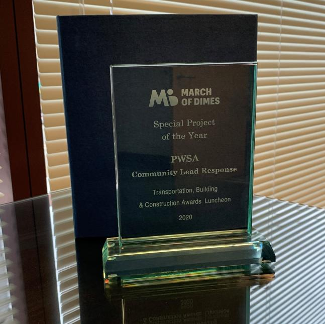 Clear glass award from March of Dimes with text recognizing PWSA's Community Lead Response as Special Project of the Year.