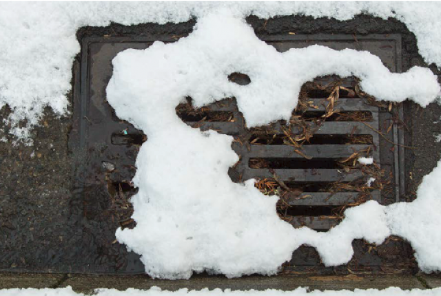 A snow covered storm drain