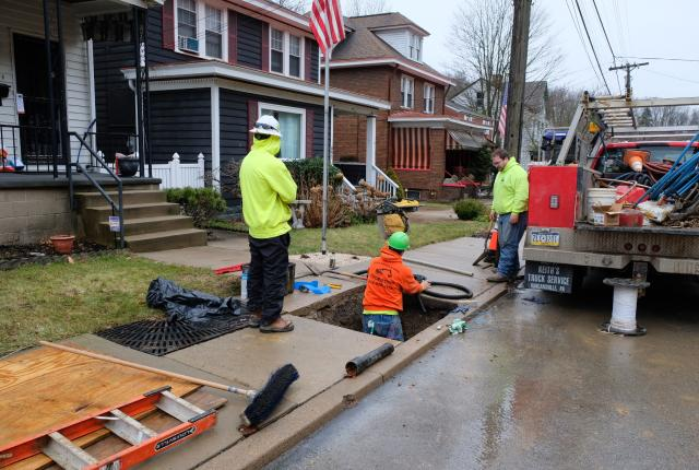 Contractors replacing a lead service line in one of Pittsburgh's neighborhoods