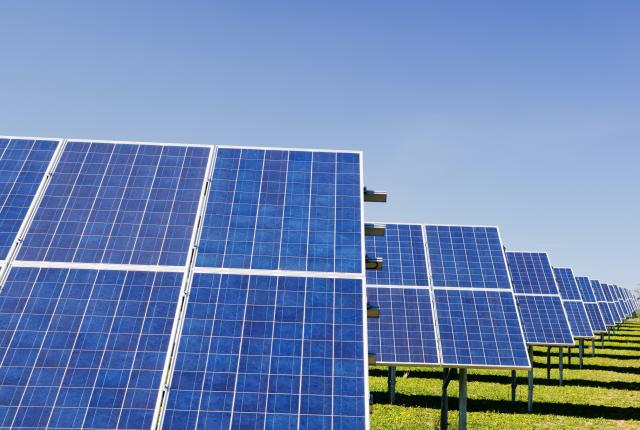 Stock image of solar farm in a rural area