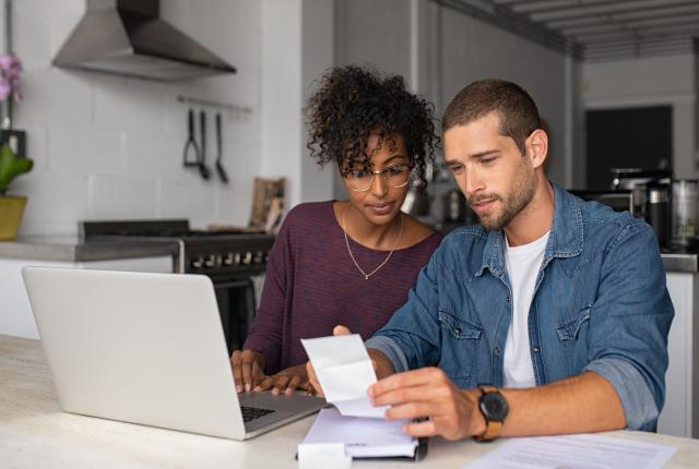 Stock photo of couple paying bills