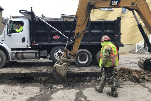 Crews replacing a water main in a Pittsburgh neighborhood.