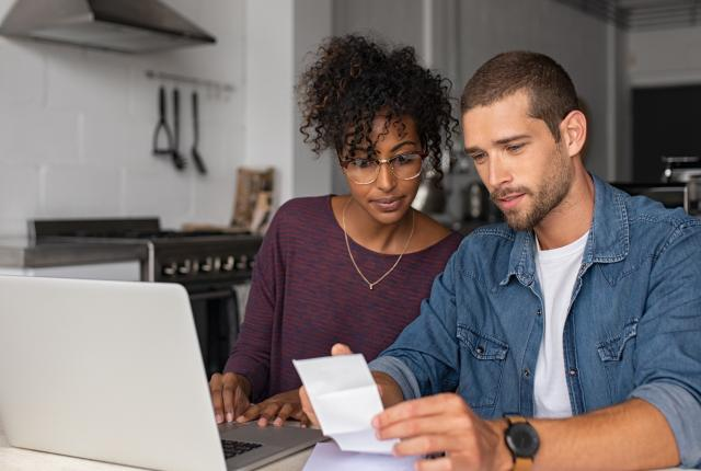 A couple reviewing a utility bill